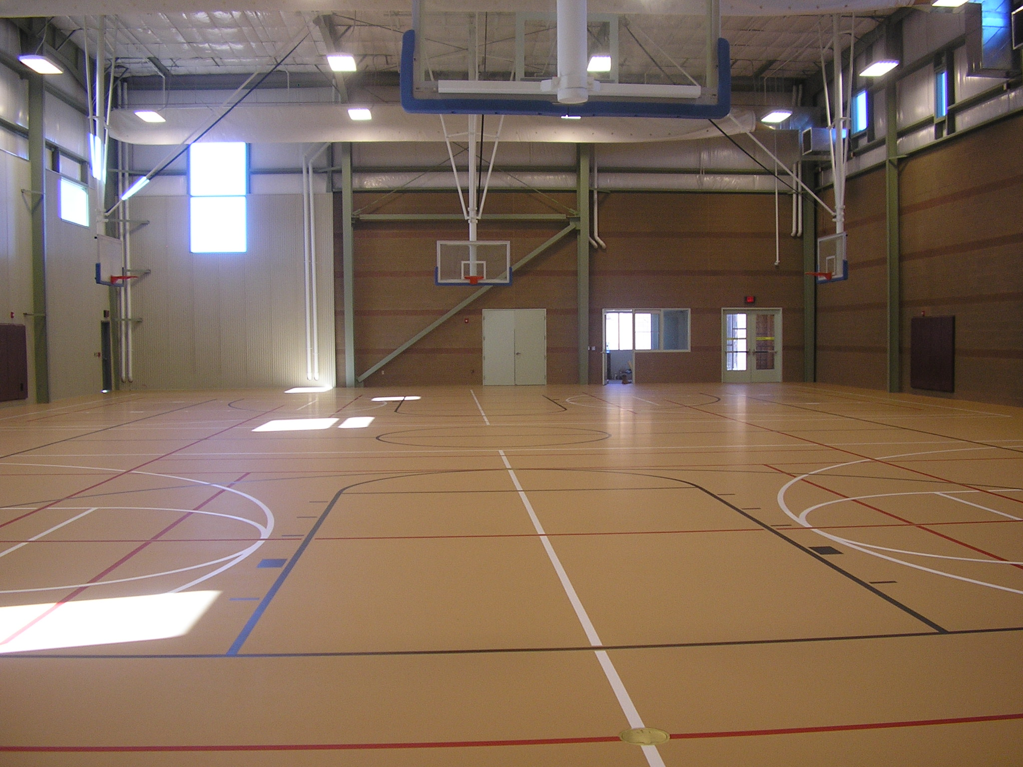 Suspended gym flooring for multipurpose basketball courts for Basketball gym floor plan