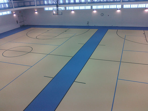 Full pour indoor basketball court for Ravenna youth programs